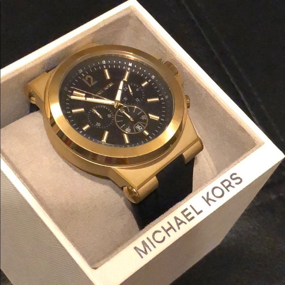 f3074f629e90 Michael Korda Black Gold Silicone Band Watch. M 5a604468a4c485d2a628be03